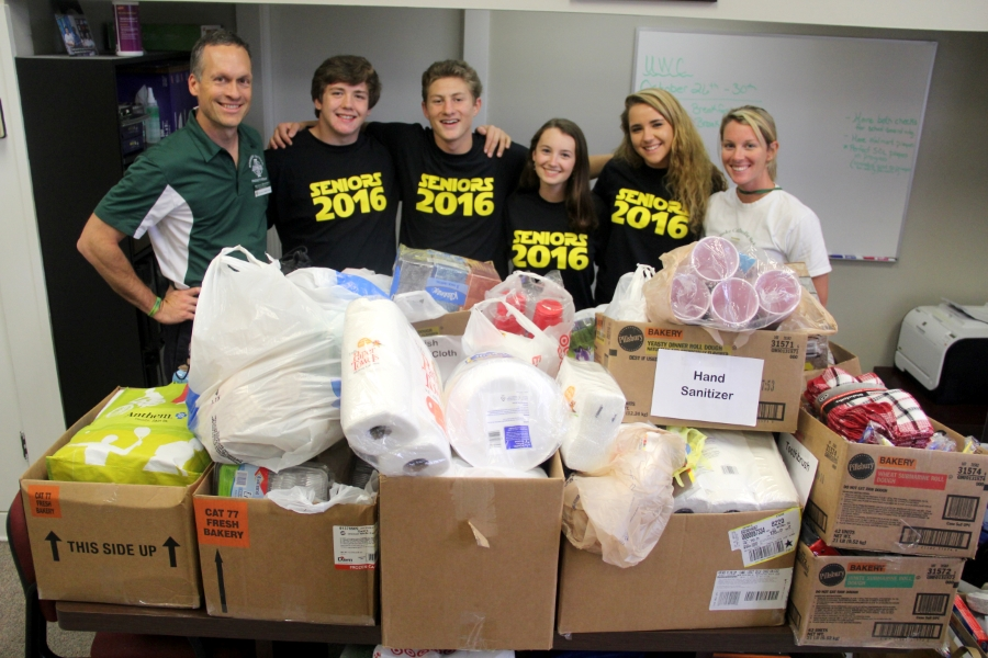 Roanoke Catholic students posing in front of donated supplies